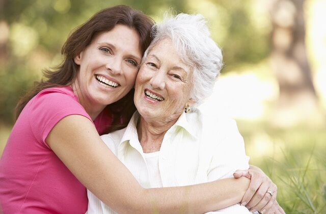 Dental implants: Two women showing their perfect smiles